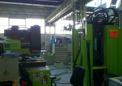 Installation of injection moulding machine equipment and robotics.